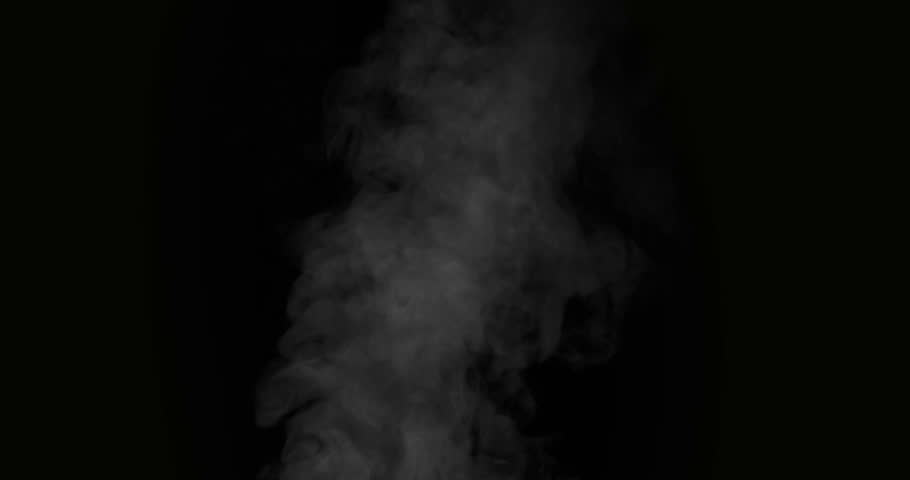 Slow Jet of Hot Steam. White Steam rises from a large pot that is behind the scenes. Black background. Filmed at a speed of 120fps
