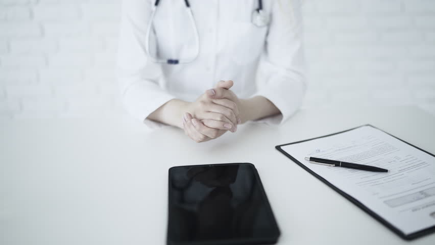 Unrecognizable female doctor advising patient in her medical office | Shutterstock HD Video #29077012