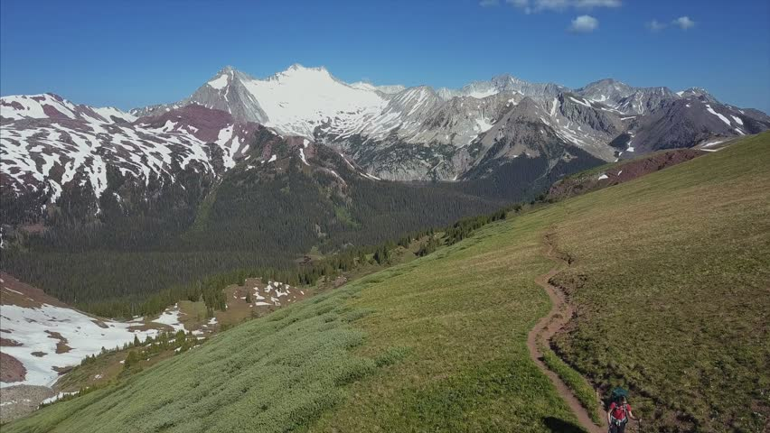 4K Aerial shot of Female Hiker walking on Mountain in Colorado wilderness