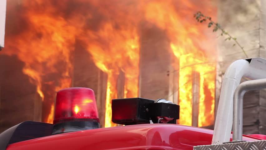 fire billowing inside a wooden house