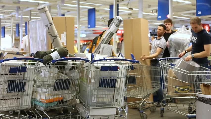 Russia, Moscow - 14 July 2017: Full shopping trolleys in IKEA store. IKEA was founded in of Sweden in 1943, IKEA to have large chain stores around the world.
