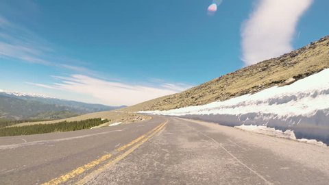 POV point of view -  Driving on alpine road of Mount Evans in Early Summer.