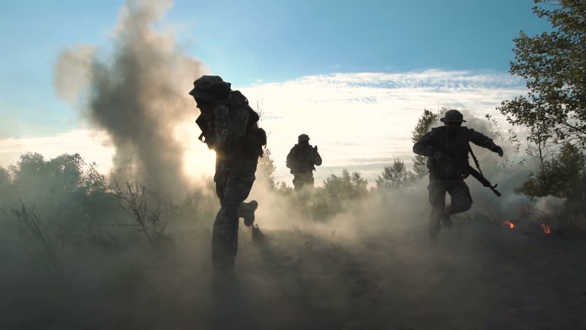 Slowmotion of silhouettes group of military men running on field in smoke and falling killed. Under mortar shelling | Shutterstock HD Video #29147452
