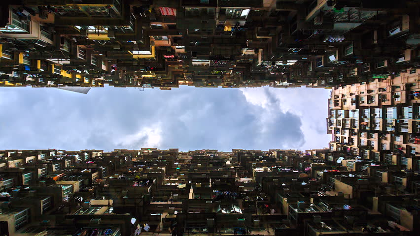 4k. Time lapse view of old Apartment with Moving Cloud in Hong Kong city of China