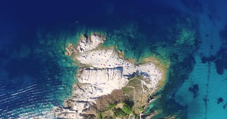 Aerial flight circulating around a Mediterranean peninsula in Italy