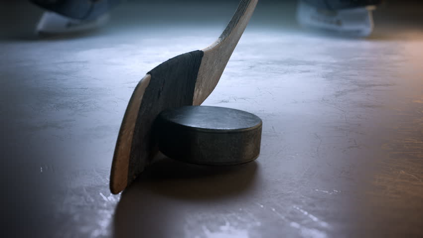 Slow motion hockey stick hitting hockey puck. Close-up | Shutterstock HD Video #29175964