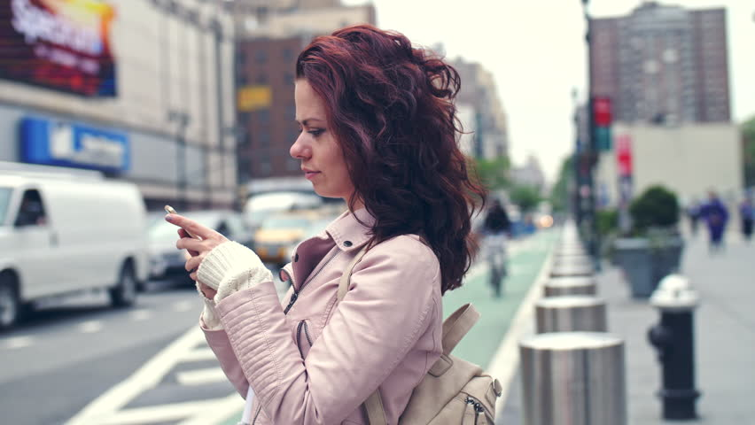 Young girl with a phone in the city | Shutterstock HD Video #29180554