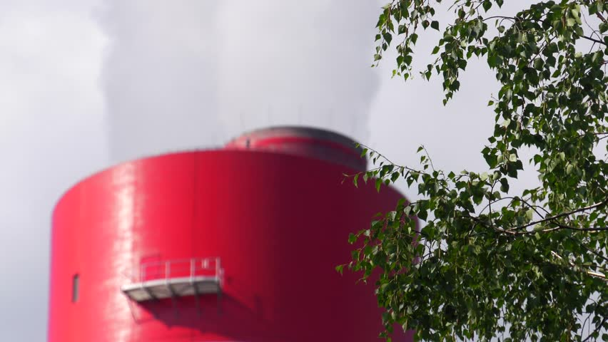 4K,60p, Big red white chimney on the site of the coal-fired power plant. Contaminated smoke (co2) rises to the atmosphere. Air contaminated. Air pollution. Closeup, Fade in out | Shutterstock HD Video #29193040