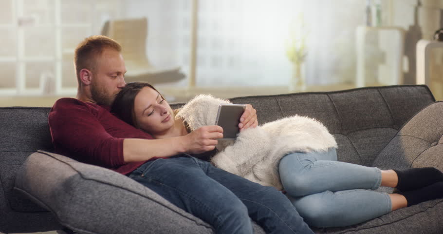 Couple Snuggling On Couch
