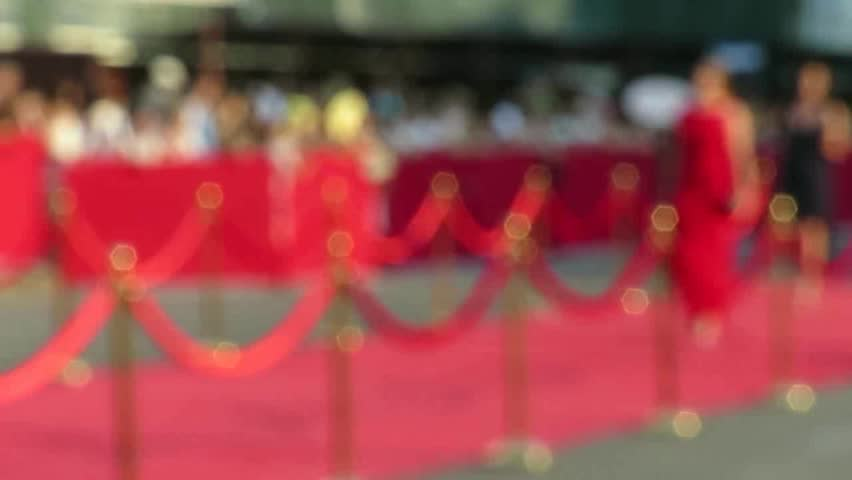 Blurred video. Red carpet entrance with golden stanchions and ropes. Celebrity nominees go to the premiere. Stars on the festive awarding of prizes awards Royalty-Free Stock Footage #29211337