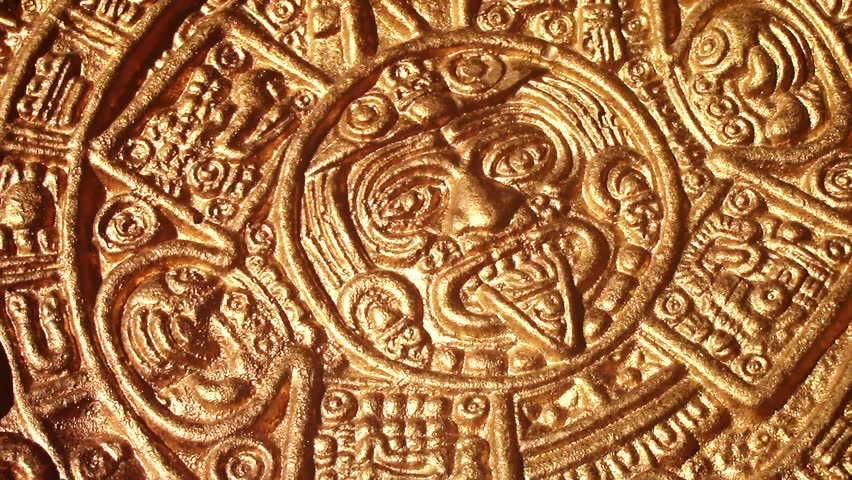 new quality footage of golden image of aztec sun circle rotating