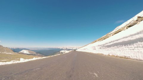 Denver, Colorado, USA-June 10, 2017.  POV point of view -  Driving on alpine road of Mount Evans in Early Summer.