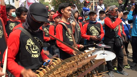 JAKARTA, INDONESIA - 1 MAY 2017: Young men play traditional music at International Workers' Day rally in Jakarta