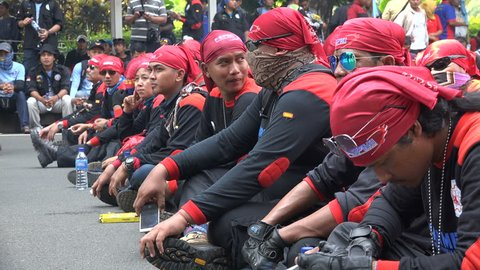 JAKARTA, INDONESIA - 1 MAY 2017: Indonesian labor union members sit on streets of Jakarta, protesting against government and demanding better wages and working conditions