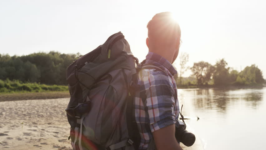 Man Standing in the Wild and Looking Around. Sunset | Shutterstock HD Video #29252812