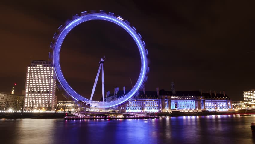 LONDON - CIRCA 2012:  Time lapse of the London Eye at night in London circa 2012.