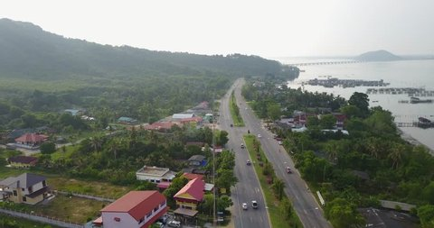 Fly over road and Sea, 4k video, Thailand