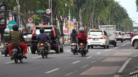 SURABAYA, INDONESIA - APRIL 2017: Traffic drives through streets of Surabaya