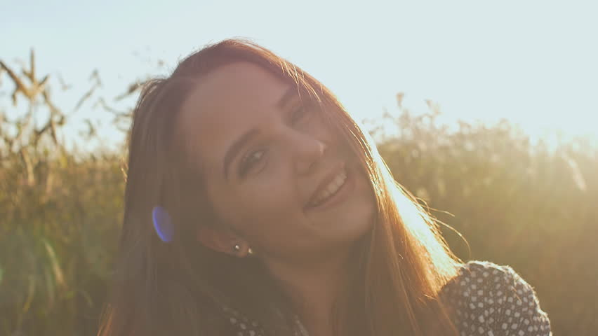 Portrait of a beautiful teenage girl in the sun at sunset.