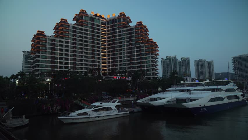 Sanya, China - April 03, 2017: Beautiful night illumination on the Sanya river embankment stock footage video