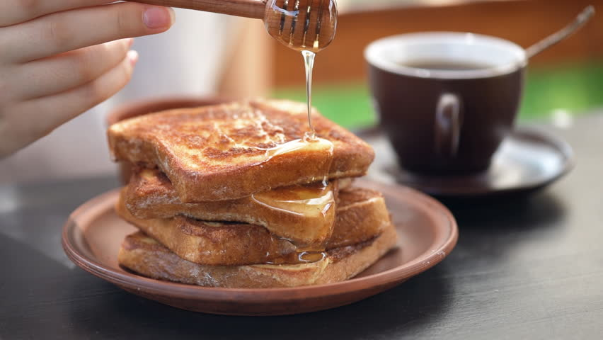 Cinemagraph -French toasts with honey. Healthy breakfast. Motion Photo. Royalty-Free Stock Footage #29350570