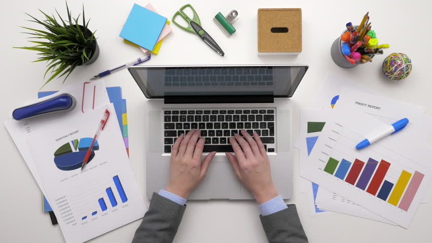 Top View Overhead Of Financial Analyst Checking Data On Laptop