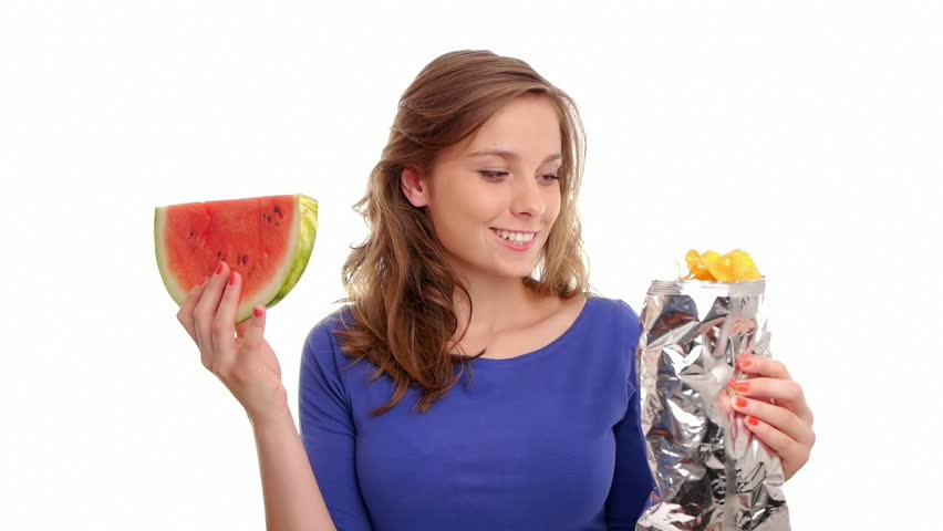 woman tempted by watermelon and potato chips chooses the red juicy fruit