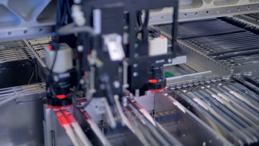 Circut Board machine Produces Printed digital electronic board.   Shutterstock HD Video #29392132