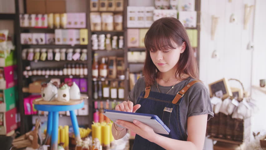 Young Deli Owner Using Digital Tablet In Delicatessen | Shutterstock HD Video #29402221
