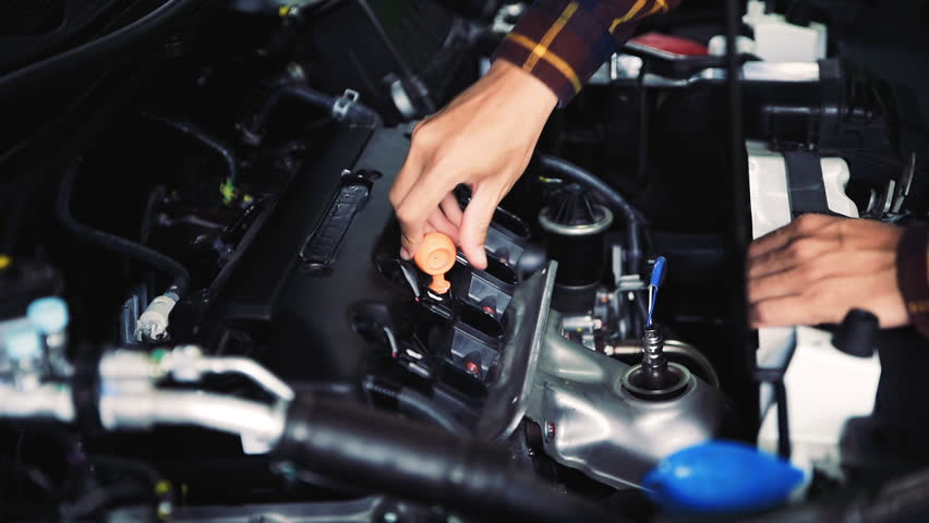mechanic is checking lube oil level of engine at car station for maintenance concept, Slow motion #29413834