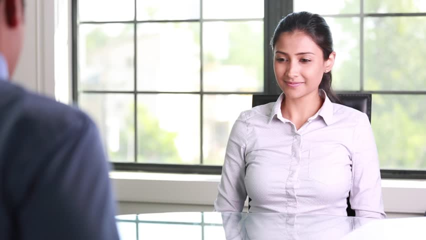 Closeup portrait, appointment with office manager, job interview, hiring, isolated indoors office background. Getting that first job or excellent customer service with a smile | Shutterstock HD Video #29414860
