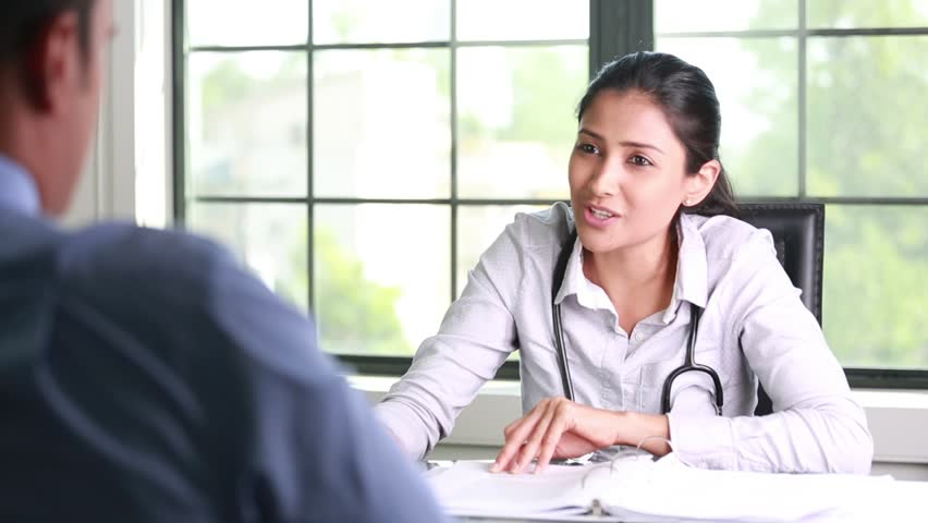 Closeup portrait, patient having conversation and signing documents with healthcare professional, isolated indoors clinic background Royalty-Free Stock Footage #29414872