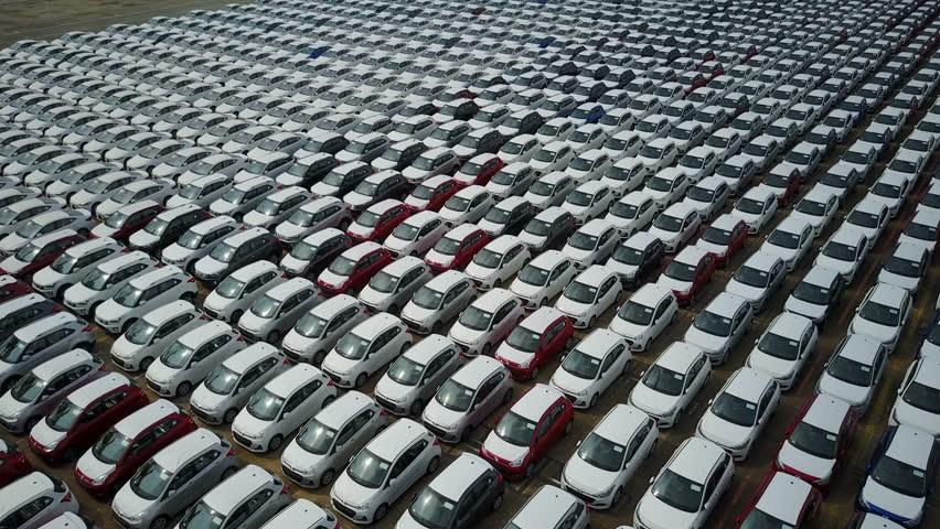 SINGAPORE - MAY 2017: Abstract aerial footage flying over new cars parked on an industrial storage platform in the Port of Singapore
