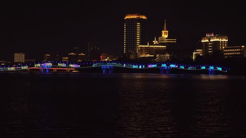 Sanya, China - April 03, 2017: Night illumination of the New pedestrian bridge Rainbow across the Sanya River time lapse stock footage video