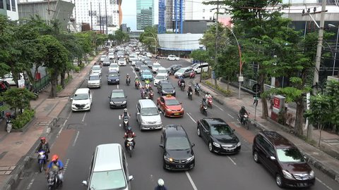 SURABAYA, INDONESIA - APRIL 2017: Busy rush hour traffic in downtown Surabaya, Indonesia's second largest city