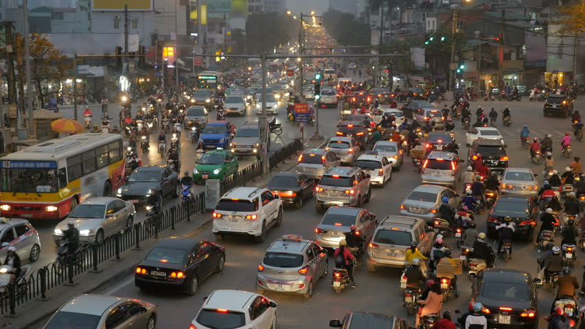 Rush hour in Hanoi, Vietnam, crowded traffic mess at intersection with cars, motorbikes, buses and many people. High angle, long shot. | Shutterstock HD Video #29430691