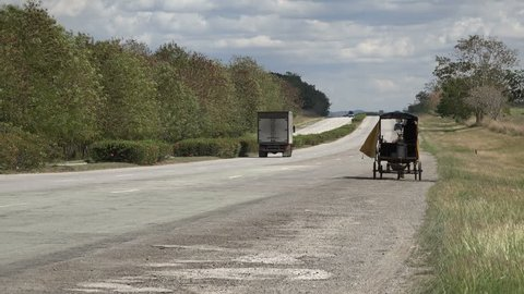 CUBA - FEBRUARY 2017: Horse cart and other traffic on the main highway in Cuba