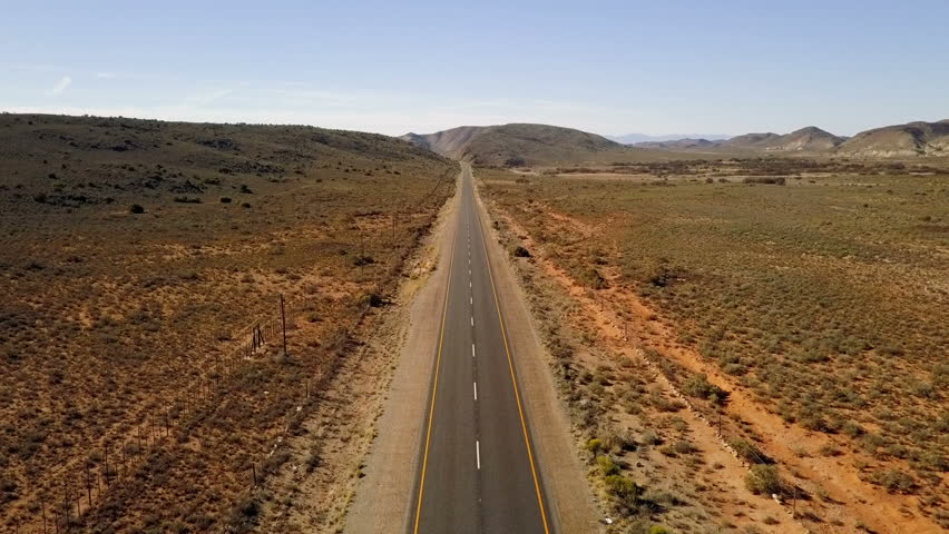 Long straight road in arid semi desert, aerial