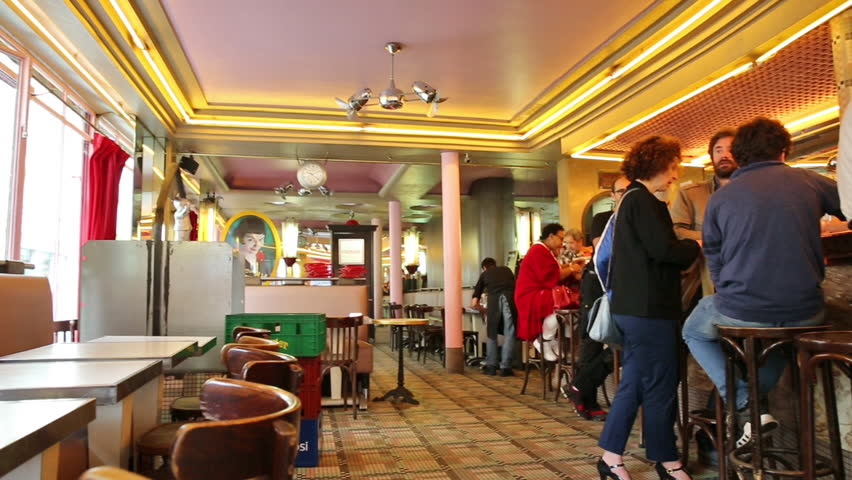 PARIS, FRANCE - JULY 3, 2017: interior panorama of popular cafe brasserie of Montmartre cafe deux moulins, location of Amelie movie on 2001. With customers enjoying their breakfast.