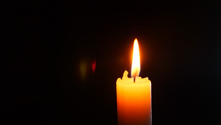 closeup of candle on black. Dying out the flame of a white candle. Smoke from the wick. 4 k. Slow-motion shooting #29453230