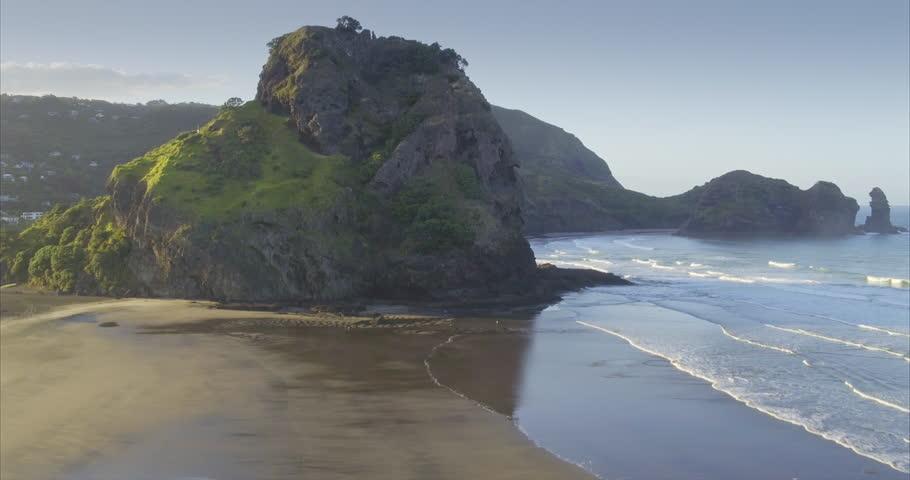 Aerial over beach at piha towards lion rock, Auckland, New Zealand