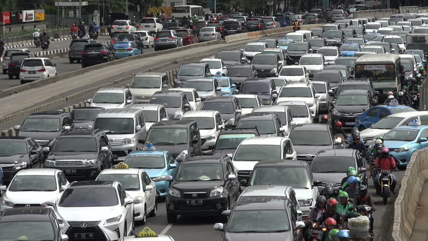 JAKARTA, INDONESIA - APRIL 2017: Commuters are stuck in slow moving traffic in Jakarta, Indonesia