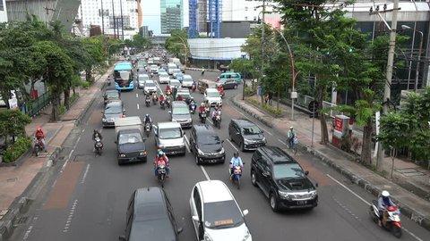 SURABAYA, INDONESIA - APRIL 2017: Busy rush hour traffic in central Surabaya, Indonesia