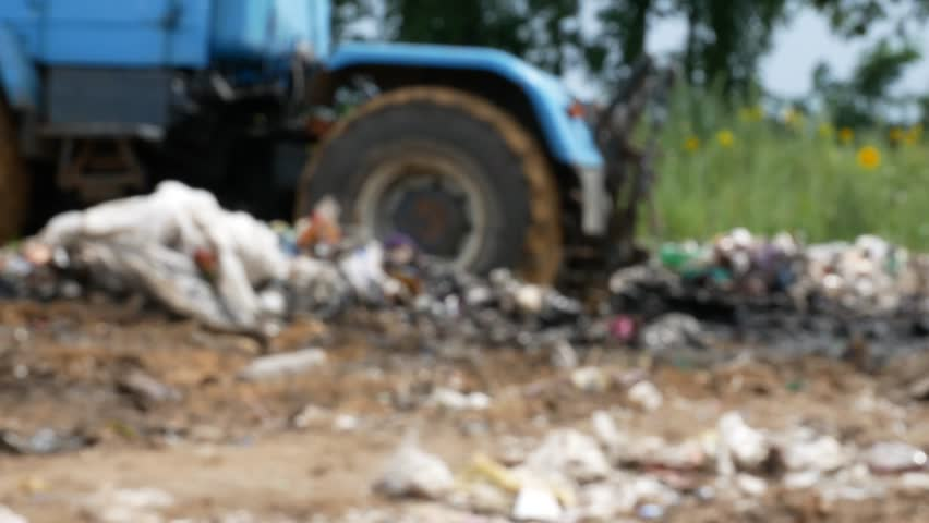Working tractor at dump