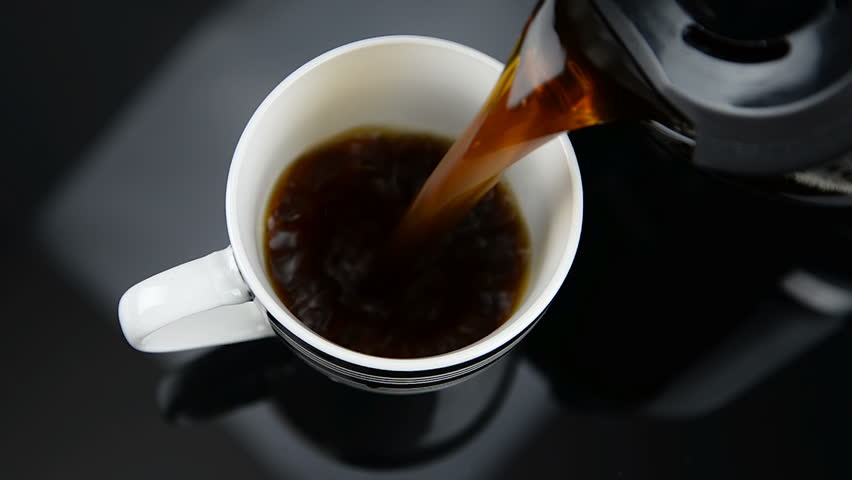 Fresh Coffee pouring into fancy cup on table top | Shutterstock HD Video #29497987