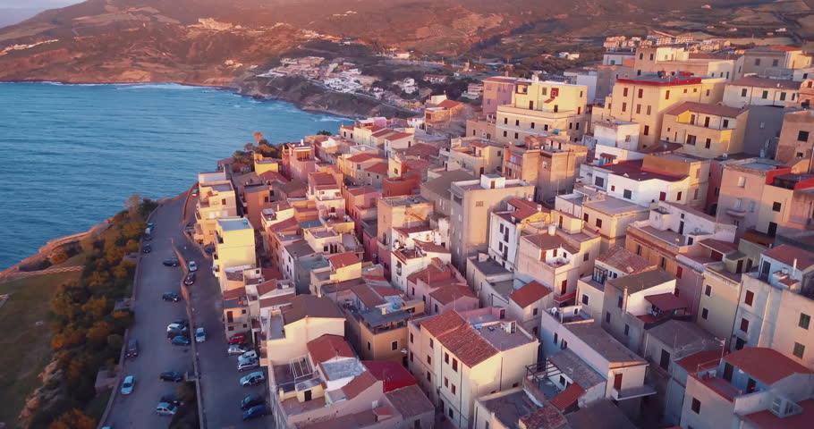 Video from above, Aerial view of Castelsardo city at sunset in Sardinia, Italy.