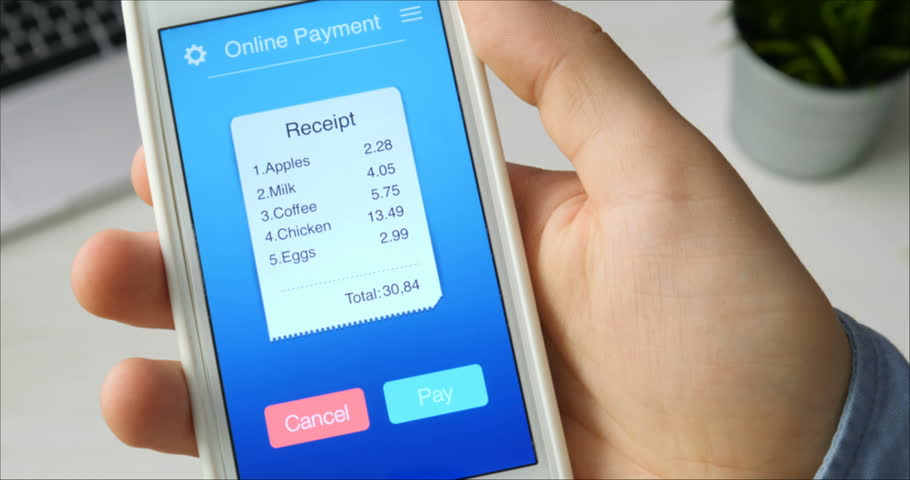 Paying for bill from a grocery store using mobile application on a smartphone #29515417