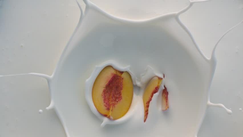 White Yogurt with Peach Fruit Falling Down