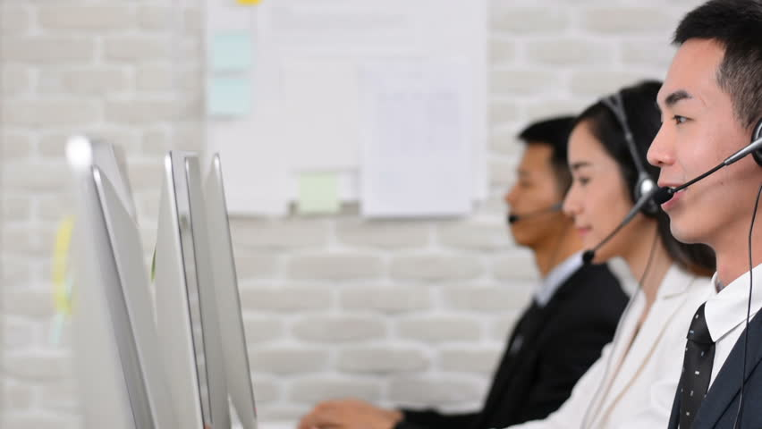 Asian telemarketing customer service agent team working in the office, call center job concept