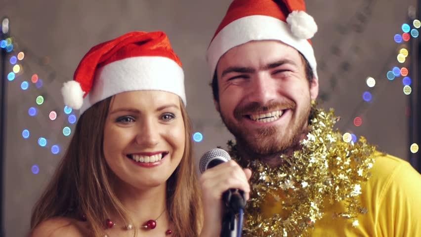 Couple singing karaoke at Christmas party #2952949